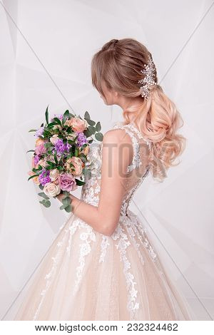 Rear View Woman Holding A Bouquet Of Flowers Wearing In Luxurious Wedding Dress Isolated On Backgrou
