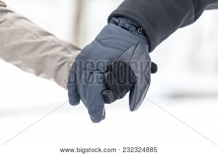 A Girl Is Holding A Male Hand