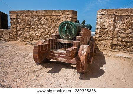 Old Cannon On Fortified Wall In Portuguese Fortress Sqala Du Port In Essaouira, Morocco, North Afric