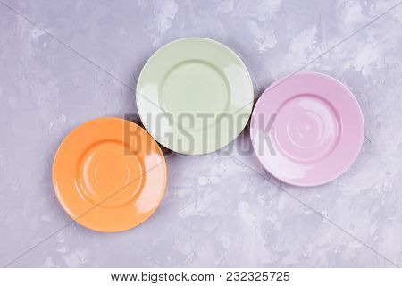 Different Multicolored Empty Plates On A Table. Table Setting. Top View. Tableware. Set Of Plates.