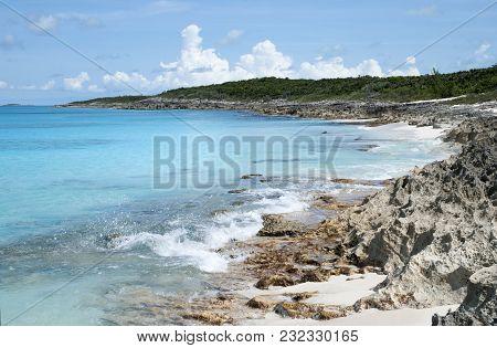 The View Of Sharp Rock Beach Spreading On Uninhabited Island Half Moon Cay (bahamas).