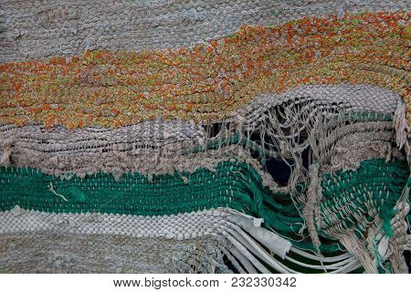 Detail Of Torn Rag, Front View Background Or Texture.