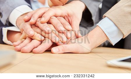 Business people stack hands as exercise for team development and cooperation