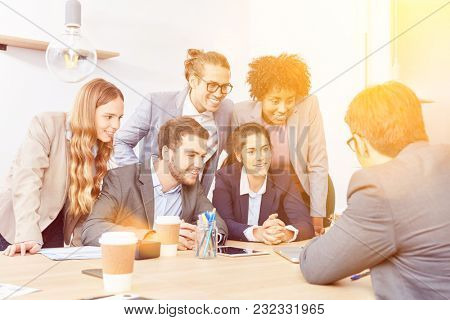 Consultation of start-up business team in the office by a businessman