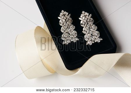 Pair Of Platinum Earrings With Diamond Earrings, Close-up. Luxury Female Gold Jewelry