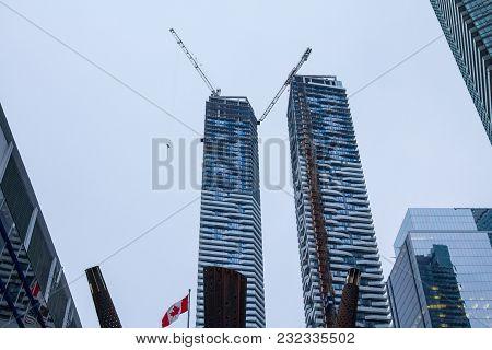 Toronto, Canada - December 21, 2016: Condo Skyscraper Construction Site In Front Of Older Buildings