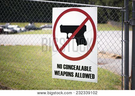 No Gun Zone Sigh On A Fence