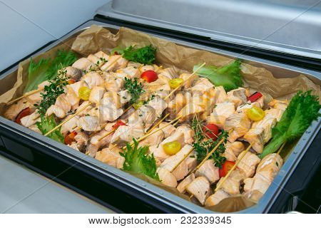 Big Plate Of Shish Kebab From Slices Of Salmon Roasted On A Grill With Vegetables. Catering Service
