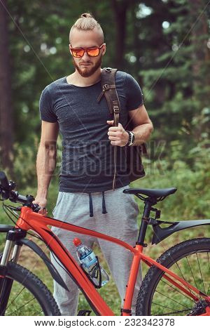 Handsome Redhead Male With A Stylish Haircut And Beard Dressed In Sportswear And Sunglasses Walks In