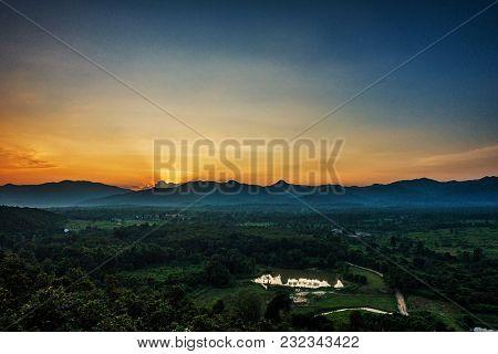 Sunset Behind Mountain.