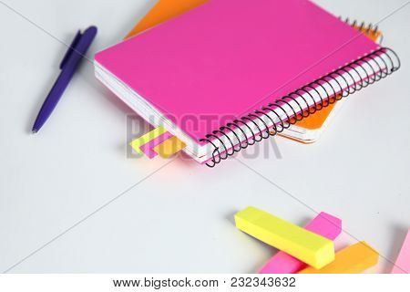 Colorful Notebooks And Office Supplies On White Table