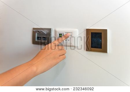 Woman Hand Being Turn On Temperature Switches Of Air Condditioning.