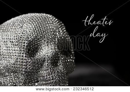closeup of a sparkly skull and the text theater day against a black background