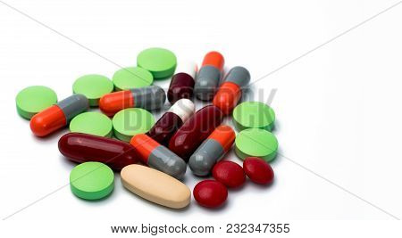 Pile Of Colorful Tablets And Capsule Pills Isolated On White Background. Drug, Vitamin, Supplement A