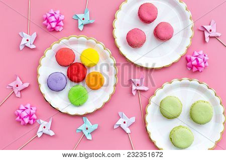 Sweets For Party Background. Macarons And Lollipop On Pink Background Top View.