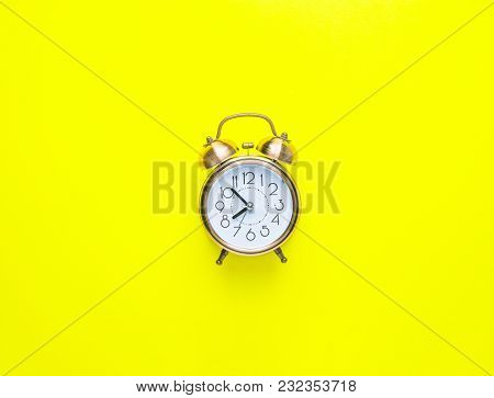 Alarm Clock Showing Eight O'clock On Bright Yellow Background. Flat Lay. Morning Sunlight. New Day B