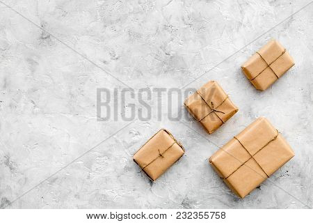 Parcels Box In Delivery Service Office On Stone Background Top View Space For Text