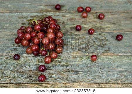 Fresh Raw Red Grape On Wooden Table On Old Wood Table Background