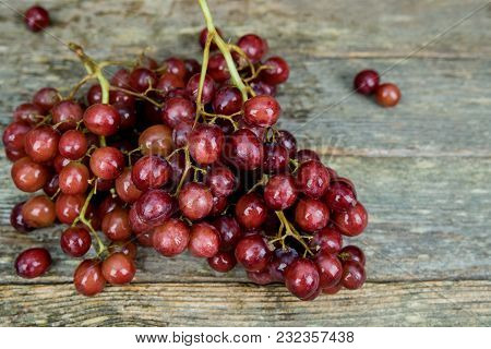 Red Grapes On A Wooden Board , Red Grapes On A Wooden Board