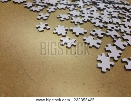 Puzzle pieces on wooden background
