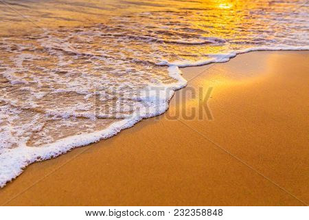 Waves On The Beach In The Tropics At Sunset