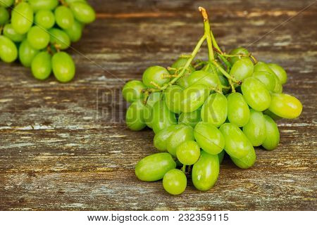 Bunch Of White Grapes On Wooden Board Food Concept White Grapes, Coarse Linen Cloth On A Wooden Boar
