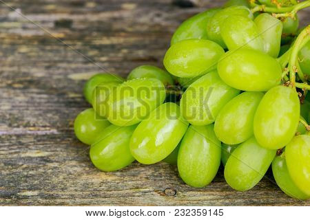 White Grapes Macro. Grapes With Drops Of Water. Grapes And Cork. Grapes On A Wooden Background