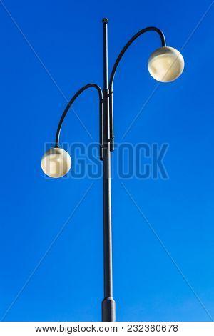 street lights on high steel pillars and blue sky