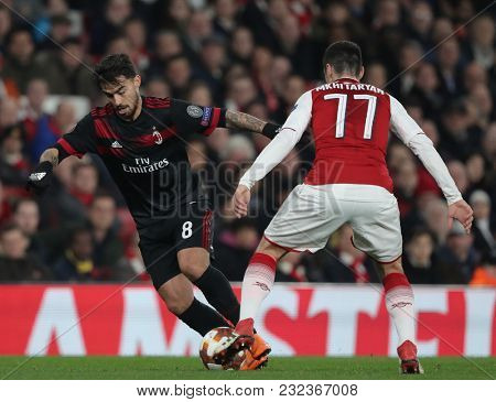 Suso of AC Milan and Henrikh Mkhitaryan of Arsenal during the Europa League match between Arsenal and AC Milan at The Emirates Stadium on March 15, 2018 in London, United Kingdom.