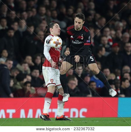 Hector Bellerin of Arsenal and Giacomo Bonaventura of AC Milan compete for the ball during the Europa League match between Arsenal and AC Milan at The Emirates Stadium on March 15, 2018 in London, .