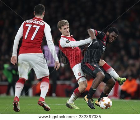 Nacho Monreal of Arsenal and Franck Kessie of AC Milan compete for the ball during the Europa League match between Arsenal and AC Milan at The Emirates Stadium on March 15, 2018 in London, UK