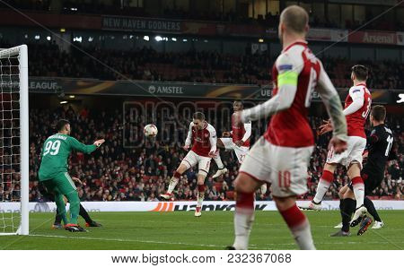 Aaron Ramsey of Arsenal heads the ball during the Europa League match between Arsenal and AC Milan at The Emirates Stadium on March 15, 2018 in London, United Kingdom.