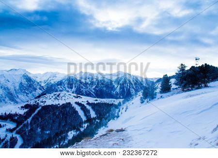 Mountain Winter Landscape In Cold Weather. The Tops Of The Mountains Are Covered With Snow.