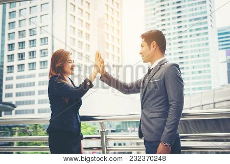 Close Up Of Happy Business People Showing High Five Sign With Team Outside.