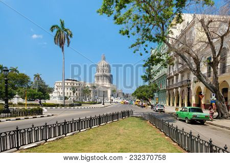 HAVANA,CUBA - MARCH 14,2018 : Street scene with the Capitol building in Old Havana on a beautiful summer day