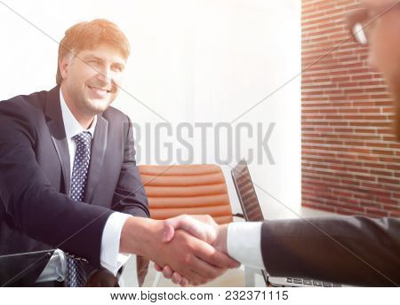 businessman stretches out his hand for a handshake