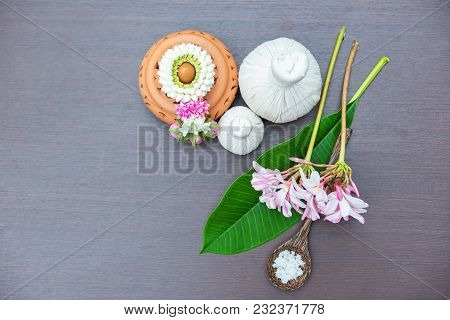 Top View Thai Spa Massage Compress Balls, Herbal Ball On The Brown Wooden With Treatments Spa For We