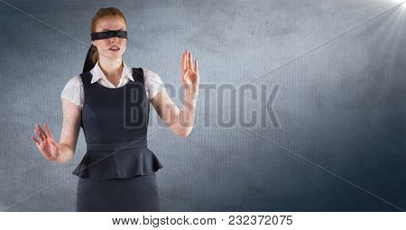 Digital composite of Business woman blindfolded against navy background with flare and grunge overlay