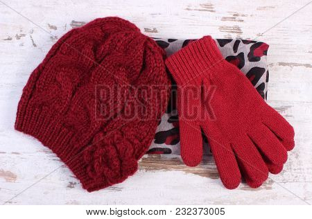 Pair Of Woolen Gloves, Cap And Colorful Shawl For Woman On Old Rustic Board, Womanly Accessories, Wa