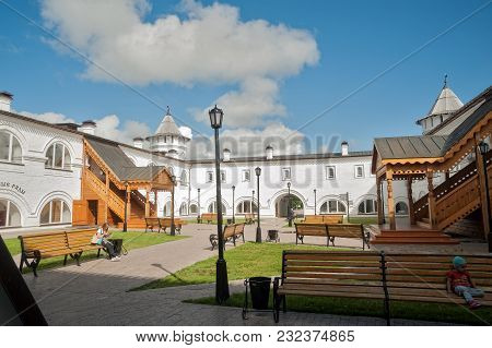Tobolsk, Russia - July 15, 2016: Woman Rests In Interior Of Guest Yard. Building Of Gostiny Dvor Is