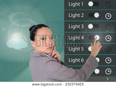 Digital composite of Woman touching Home automation system lighting App Interface