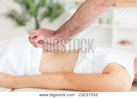 Cute Woman getting a back-massage in a room