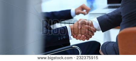 handshake of business partners on blurred background