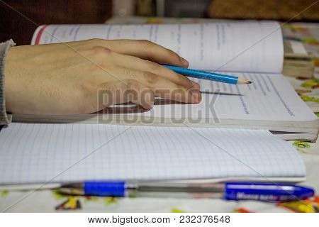 Hand On The Training Sheet Of The Document And The Book For The Exam