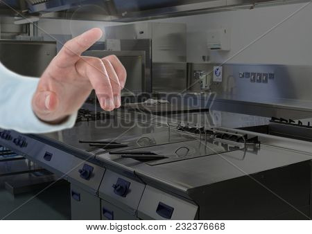 Digital composite of Hand touching air in chef kitchen