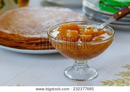 Sweet Apricot Jam And Pancakes On The Dining Table