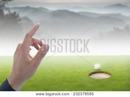 Digital composite of Hand Touching air of golf course