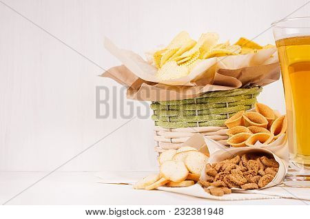Golden Crunchy  Snacks Collection And Lager Beer In Glass On Soft White Wood Board. Summer Fast Food