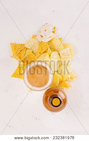 Heap Beer Junk Snacks Ang Golden Lager Beer In Glass, Brown Bottle On Soft White Wooden Background.