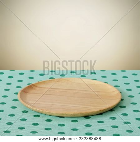 Empty Wooden Tray On Table With Green Tablecloth Over Cement Wall Background, Food Background